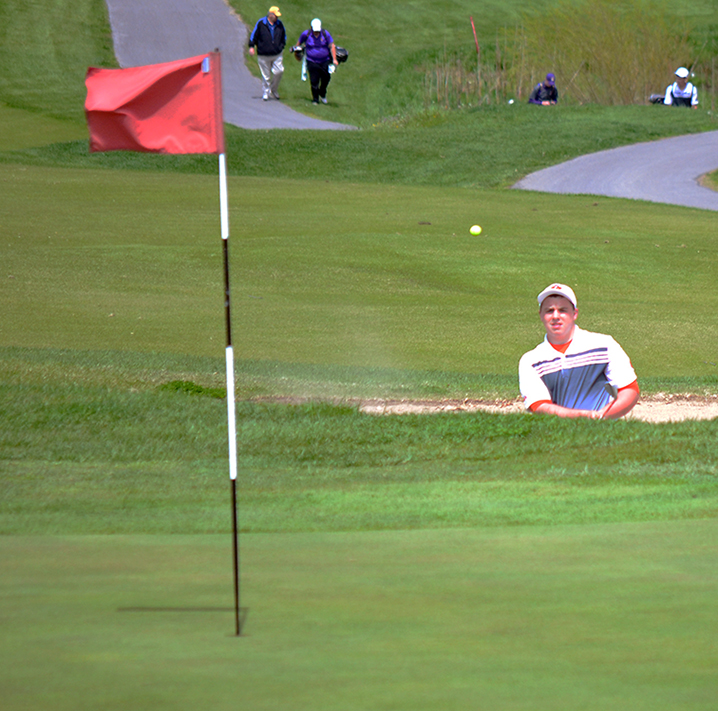 BRYCE MERENESS/Citizen photo Platte County's Adam Muehlebach hits out of the bunker during the Suburban Conference Blue Division Tournament on Monday, April 27 at Paradise Pointe Golf Complex in Smithville, Mo.