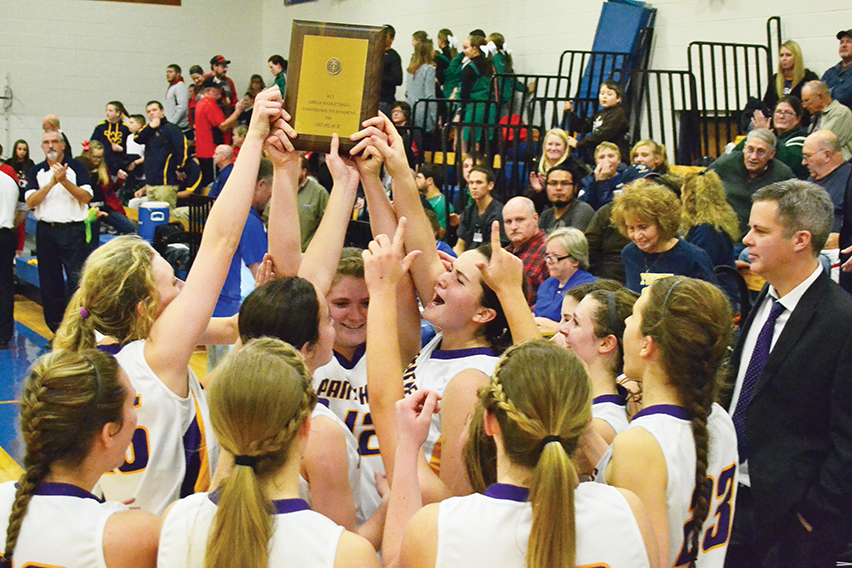 BRYCE MERENESS/Citizen photo Members of the North Platte girls basketball team celebrate with the first place trophy after defeating Hamilton 57-55 in overtime of the KCI Conference Tournament championship game on Friday Dec. 12 at West Platte High School in Weston, Mo.