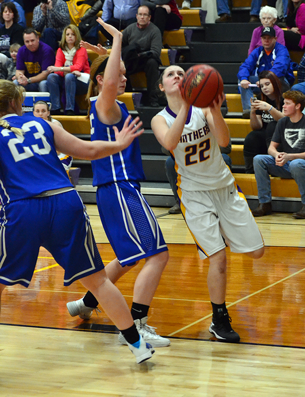 BRYCE MERENESS/Citizen photo North Platte junior guard Emmie Lee, right, drives to the basket against West Platte sophomore Nealie Niemeier, center, during a game Friday, Jan. 9 at North Platte High School in Dearborn, Mo. North Platte won the game 46-24 to stay unbeaten on the season.