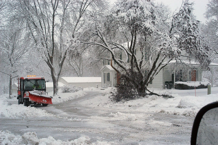 Coming just five days after one of the worst snowstorms in years, Tuesday's winter storm slammed Platte County with 8-10 inches of heavy, wet snow, which snapped tree branches — like the one above at Platte City Mayor Frank Offutt's house.