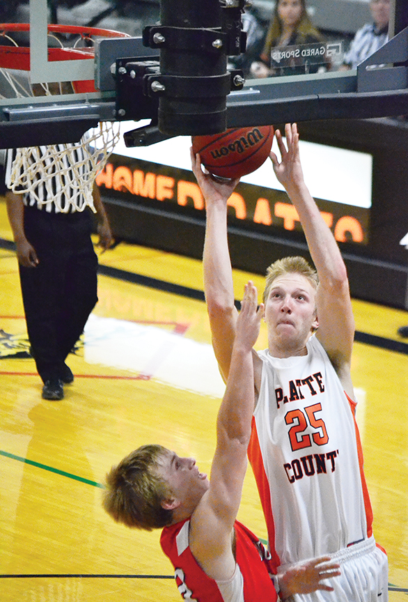 BRYCE MERENESS/Citizen photo Platte County forward Blake Stewart (25) goes up for a shot against a Fort Osage defender in a game on Dec. 8 at Platte County High School. Platte County won 57-51.