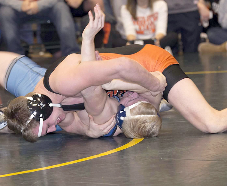 DAVID BREDESON/Special to The Citizen Platte County's Johnny Blankenship, top, pins St. James Academy's Clay Lautt in the third-place bout of the Basehor-Linwood Bobcat Classic on Saturday, Jan. 20 at Basehor-Linwood High School in Basehor, Kan.