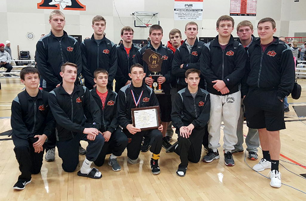 Contributed photo Members of the Platte County wrestling team pose with the sixth-place trophy after the Cheesehead Invitational, held this past weekend in Kaukauna, Wisc. The elite tournament featured eight teams in InterMat Wrestling's top 50 national rankings, including the No. 33 Pirates.