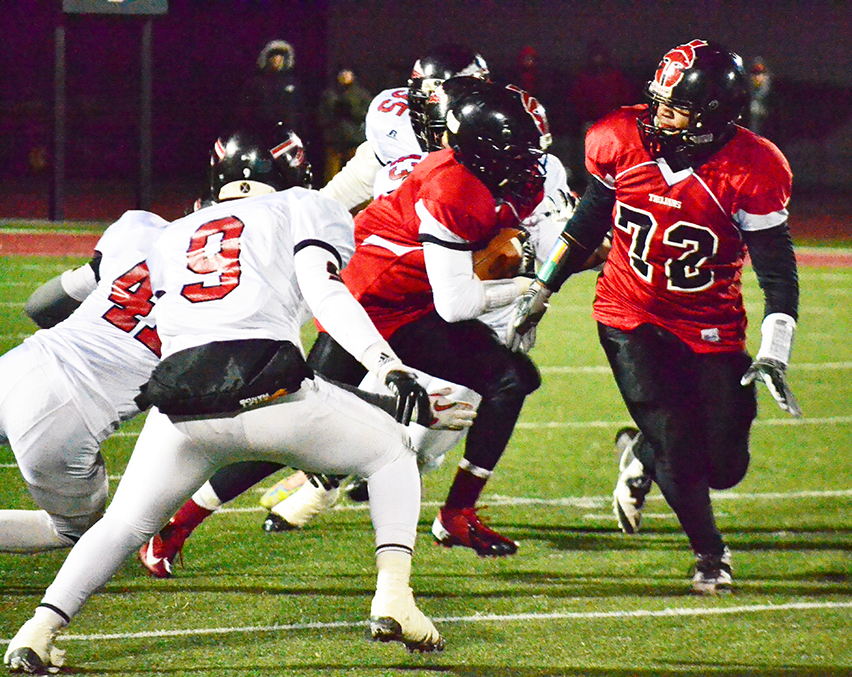 BRYCE MERENESS/Citizen file photo Park Hill senior offensive lineman Joe Tuimauga (72) clears a path for a runner during a Missouri Class 5 quarterfinal against Fort Osage on Nov. 14 at Park Hill District Stadium in Kansas City, Mo. Park Hill won 21-20 to advance to the semifinals for the second time in school history. The Trojans 12-1 record tied them for the most wins in the program's history.