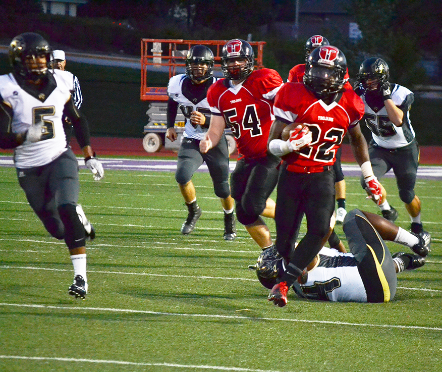 BRYCE MERENESS/Citizen photo Park Hill running back Matt Harris, right, carries the ball Oct. 3 at Park Hill District Stadium in Kansas City,  Mo., while pursued by Lee's Summit defensive back Delshon Spratt (5). The Trojans defeated the Tigers 44-33.