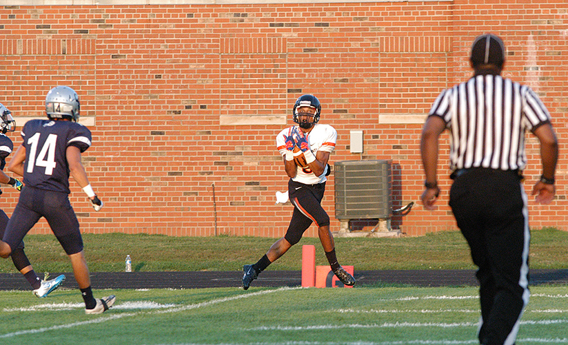 Aliek Reed reeled in a touchdown pass from Pirates quarterback Tyler Cooper in the first quarter Friday night.