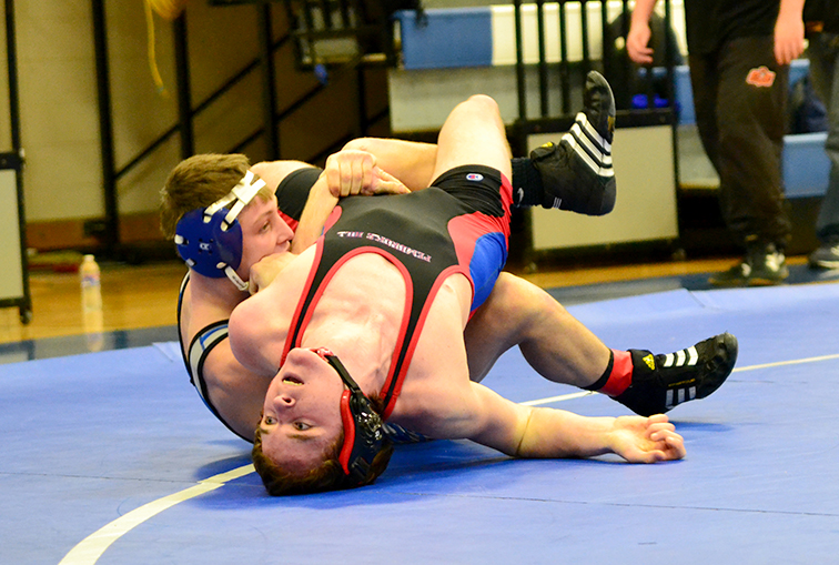 BRYCE MERENESS/Citizen photo West Platte junior Justin Rhodes, left, works to pin an opponent during the West Platte Invitational on Saturday, Jan. 31 at West Platte High School in Weston, Mo.