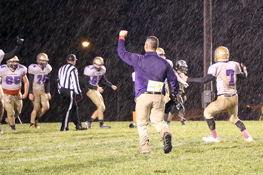 LEANN WILSON/Special to The Citizen North Platte coach Josh Rodriguez, center, and senior quarterback Anthony Hernadez, right, celebrate following North Platte's upset win against Wellington-Napoleon on Friday, Oct. 30 at Wellington-Napoleon High School in Wellington, Mo.