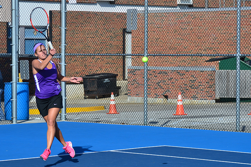 BRYCE MERENESS/Citizen photo Park Hill South's Adele Royle hits a return against Oak Park's Lauren Sullivan Oct. 4 at Oak Park High School in Kansas CIty, Mo. Royle earned district champion honors for the third straight year.