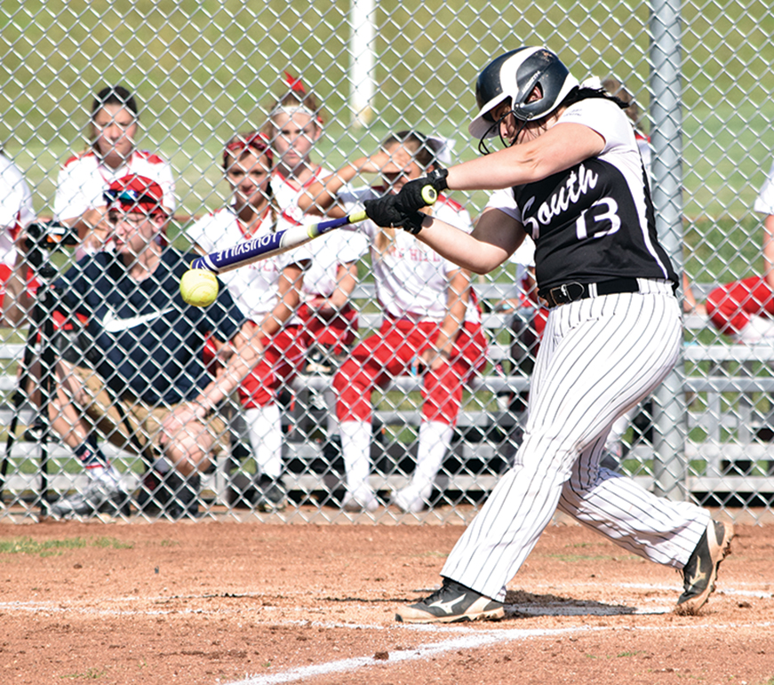 BRYCE MERENESS/Citizen photo Park Hill South designated player Erica Lutgen hits a pitch on Wednesday, Sept. 9 at Park Hill South High  School in Riverside, Mo.