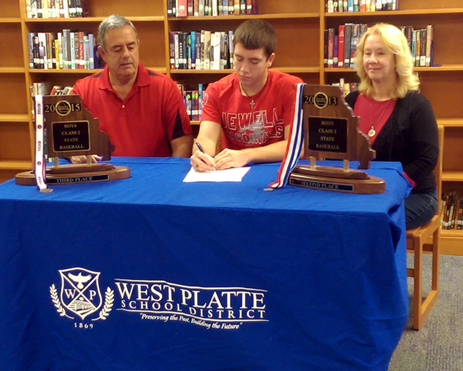 BRYCE MERENESS/Citizen photo West Platte senior McKaulley Stephenson, center, inks his national letter of intent to play baseball at William Jewell on Friday, Nov. 13 at West Platte High School in Weston, Mo.