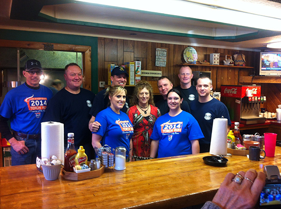 Local Missouri Highway Patrol officers recently waited tables in Platte City to benefit Special Olympics. Pictured, from left, are Sgt. Dale Chenoweth, Lt. Tim Deshler, Sgt. D.J. Hedrick, Linsey Triplett, Tammy Berry, Lindsay Spinnger, Cpl. Chad Kutzner, Cpl. Carl Taibi and Lt. Scott Shipers.
