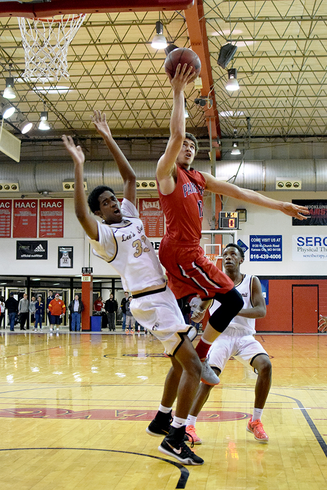 BRYCE MERENESS/Citizen photo Park Hill senior guard Brandon Townsell, center, goes in for a layup against Lee's Summit in the William Jewell Holiday Classic's Patterson Division title game Wednesday, Dec. 30 in Liberty, Mo.