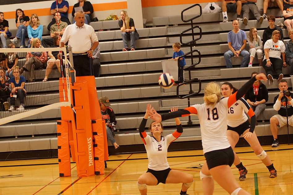CHRIS PATTERSON/Citizen photo Platte County senior Mickey Trimble, center, sets a ball for senior Maren Mair (18) in a match vs. Belton on Oct. 16 at Platte County High School. The Pirates won the match 2-0 to win the Suburban League Blue Division title.