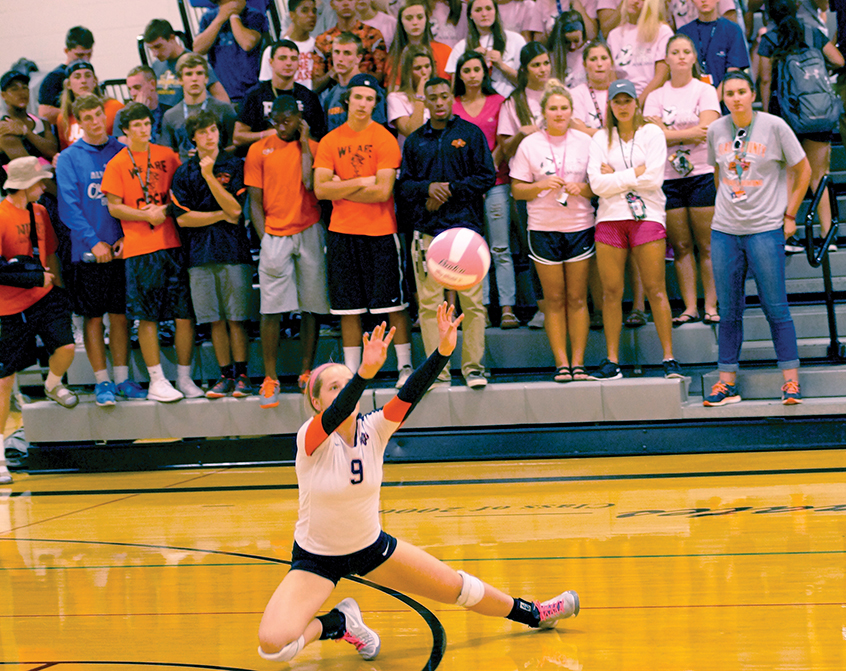 CHRIS PATTERSON/Citizen photo Platte County's Mikayla Wheeler (9) hits a set in the Dig for the Cure night on Monday, Sept. 28 at Platte County High School. The Pirates swept Lee's Summit West in a nonconference matchup.