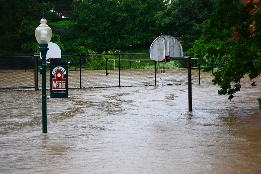 BRYCE MERENESS/Citizen photo A large amount of water collected and flooded the basketball and volleyball and tennis courts on the afternoon of Monday, July 6 at Weston City Park in Weston, Mo. Flash flooding occurred throughout the area during a heavy round of thunderstorms.