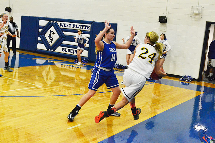 BRYCE MERENESS/Citizen photo West Platte senior guard Mattie Vandel (14) defends Hamilton's Molly Ward in the opening round of the KCI Tournament on Saturday, Dec. 6 at West Platte High School in Weston, Mo.