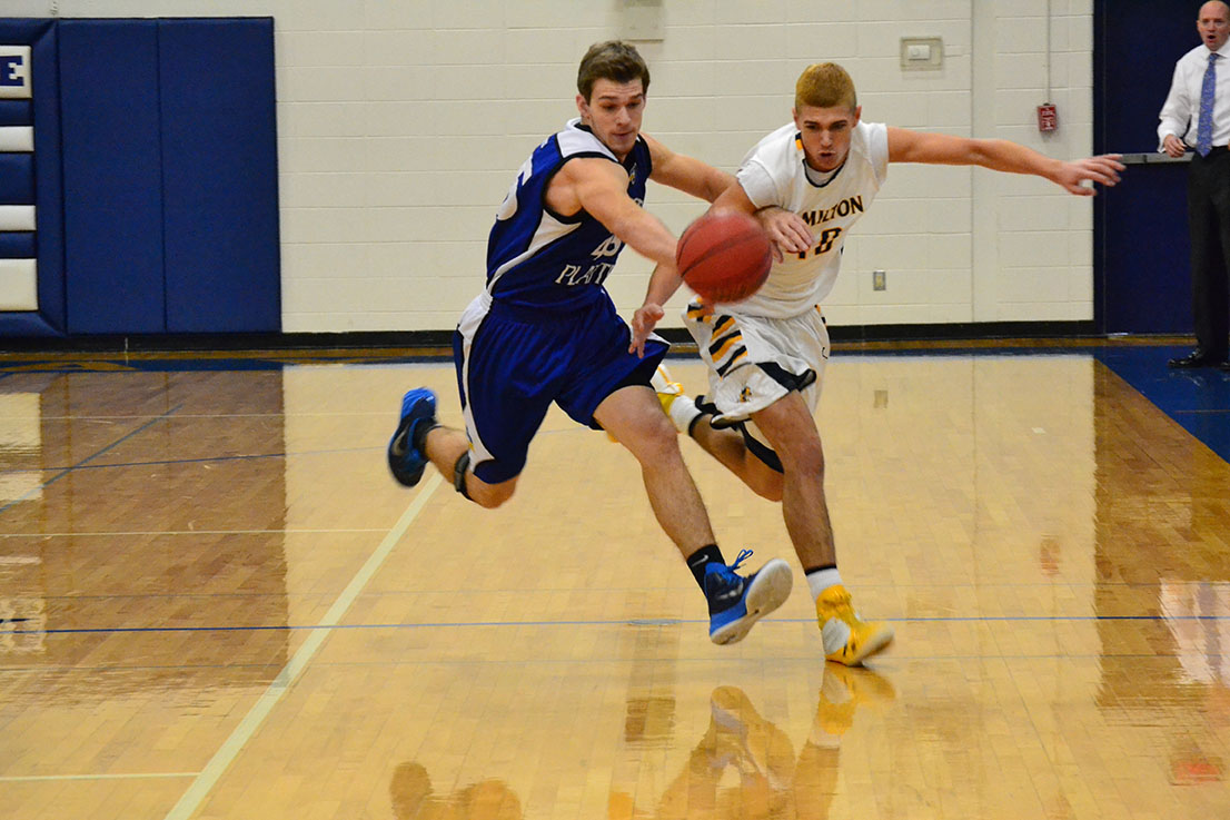 BRYCE MERENESS/Citizen photo West Platte senior forward Conner Salmons, left, chases down a loose ball with Hamilton's Telly Harper in the opening round of the KCI Conference Tournament on Dec. 6 at West Platte High School in Weston, Mo.