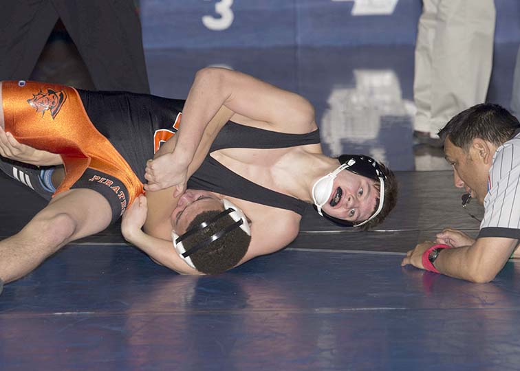 DAVID BREDESON/Special to The Citizen Platte County junior Ethan Karsten, top, works to pin an opponent in the 145-pound bracket of the Gardner-Edgerton Invitational on Dec. 6 in Gardner, Kan. Karsten was the only Platte County wrestler to earn an individual title in the 16-team event.