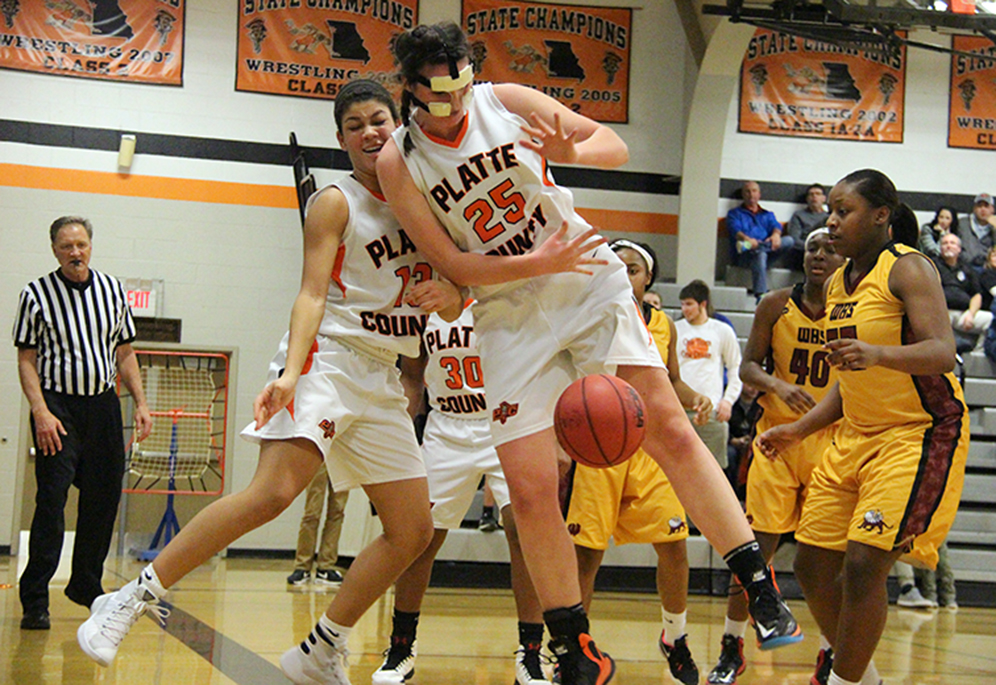 ROSS MARTIN/Citizen photo Platte County senior Rachel Holden (25) tries to save a loose ball while colliding with teammate Ava White (left) during a game against Winnetonka on Thursday, Feb. 11 at Platte County High School.