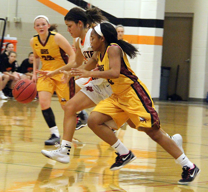 ROSS MARTIN/Citizen photo Platte County junior Ava White pokes the ball away for a steal against Winnetonka on Thursday, Feb. 11 at Platte County High School.