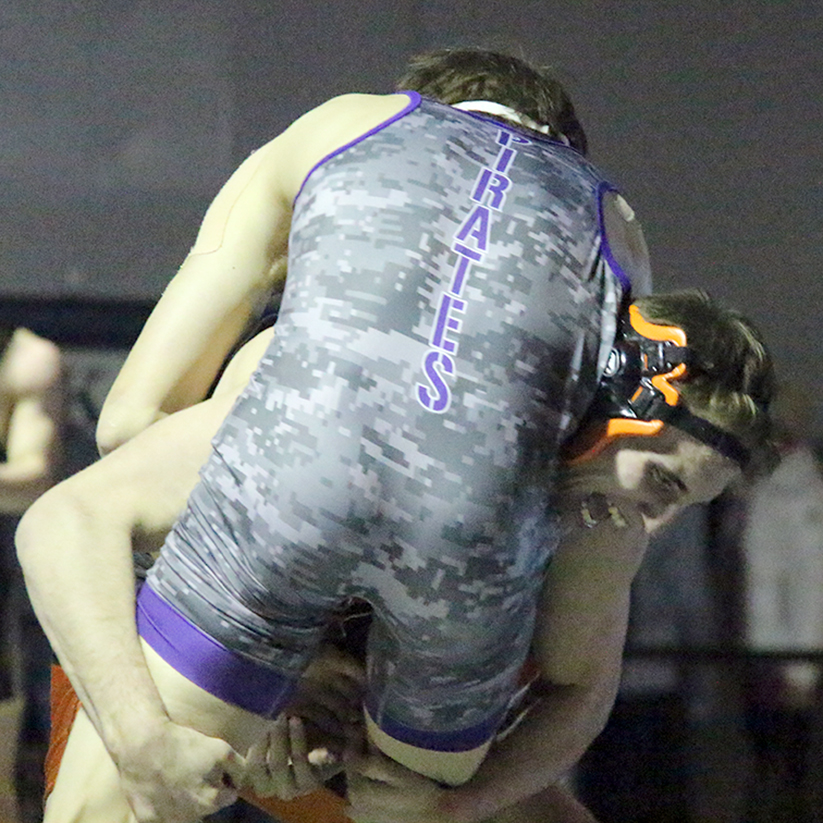 ROSS MARTIN/Citizen photo Platte County senior Johnny Blankenship, rear, takes down Belton's Jacob Benson during the 160-pound title bout.