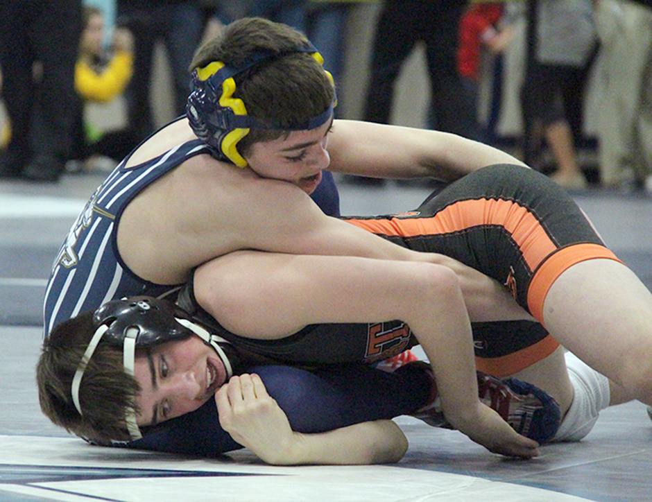 ROSS MARTIN/Citizen photos Platte County sophomore Cody Phippen, right, tries to take down Helias' Evan Winder during a Class 3 District 4 106-pound semifinal Saturday, Feb. 13 at Oak Park High School in Kansas City, Mo.