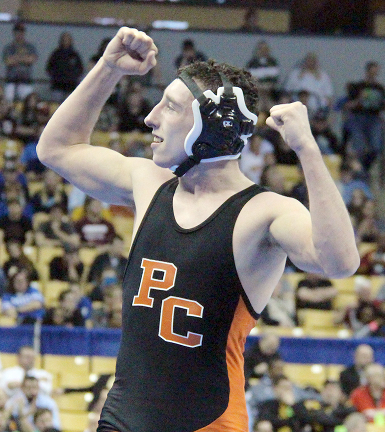 ROSS MARTIN/Citizen photo Platte County senior Matthew Schmitt flexes toward the Pirates crowd after winning the Class 3 132-pound championship in the Missouri State Wrestling Championships on Saturday, Feb. 20 at Mizzou Arena in Columbia, Mo.