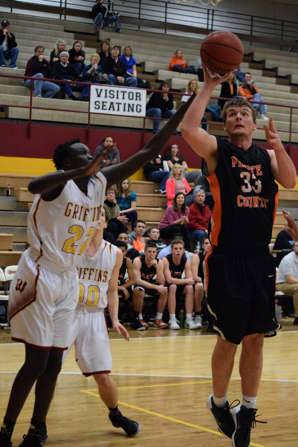 BRYCE MERENESS/Citizen photo Platte County junior Grant Carver, right, takes a shot against Winnetonka on Friday, Feb. 26 at Winnetonka High School in Kansas City, Mo.