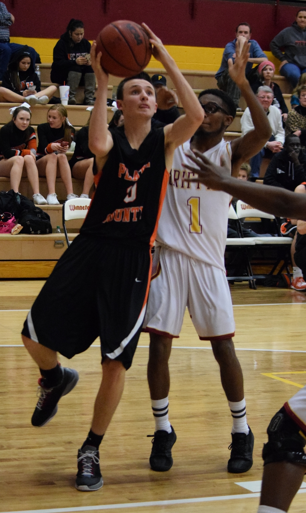 BRYCE MERENESS/Citizen photo Platte County junior Tanner Newberry, left, takes a shot against Winnetonka on Friday, Feb. 26 at Winnetonka High School in Kansas City, Mo.