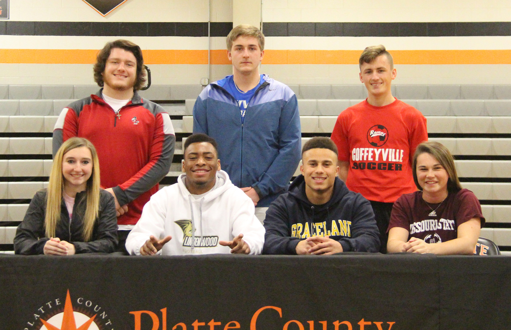 ROSS MARTIN/Citizen photo Platte County seniors (front row, from left): Maddi Hayes, Lloyd Lockett, Christian Encarnacion and Brooke Zenner and (back row, from left): Dane Rader, Conner Welch and Baylor Cox were honored during a signing ceremony held Wednesday, Feb. 24 at Platte County High School.