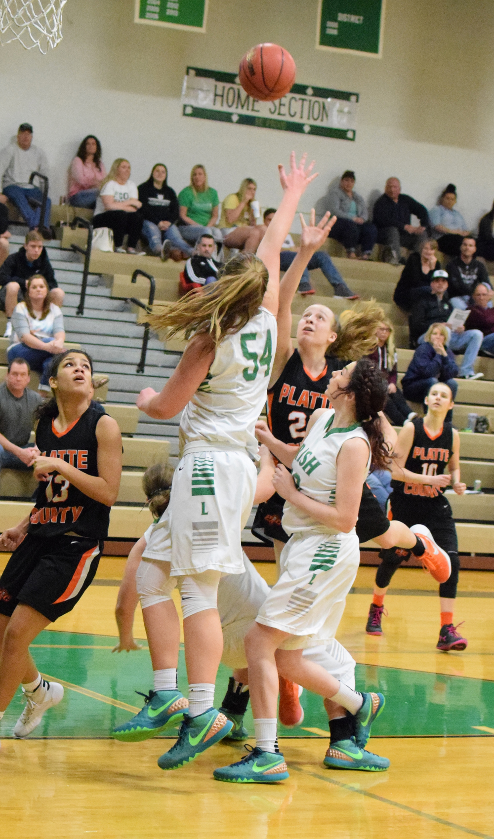 BRYCE MERENESS/Citizen photo Platte County freshman Jaycie Stubbs, right center, takes a shot against Lafayette in the first round of the Class 4 District 16 tournament on Saturday, Feb. 27 at Smithville High School in Smithville, Mo.