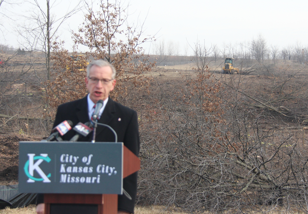 ROSS MARTIN/Citizen photo Kansas City second district councilmember Dan Fowler speaks at a press conference held Friday, March 4 at the intersection of N. Platte Purchase Drive and NW 88th Street in Kansas City, Mo. Behind him, work continues on the announced site of a Costco wholesale store to be located on the western edge of Clay County.