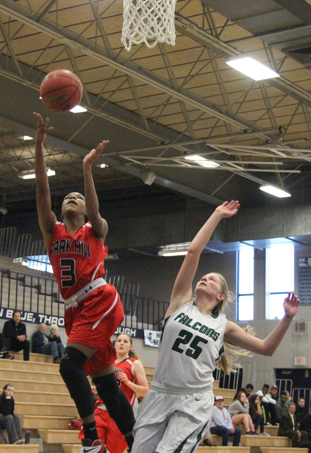ROSS MARTIN/Citizen photo Park Hill junior guard Gigi Hopkins, left, goes in for a layup against Staley's Victoria DeFerraris during a Class 5 District 16 semifinal Thursday, March 3 at Oak Park High School in Kansas City, Mo.