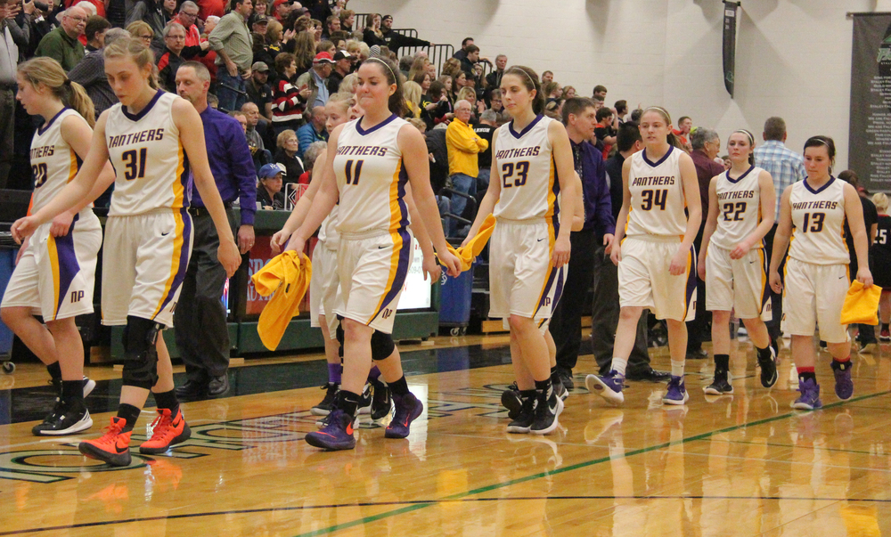 ROSS MARTIN/Citizen photo North Platte players including seniors Brittney Gerling (25), Erin Manville (31), Kailey Pike (32), Kaycee Hodgson (11) and Holly Sanders (23) walk off the court following a Class 2 sectional loss to Santa Fe on Wednesday, March 2.