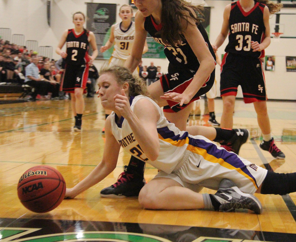 ROSS MARTIN/Citizen photo North Platte senior Brittney Gerling, front, goes to the ground after a loose ball Wednesday, March 2 in the second half of a Class 2 sectional at Staley High School in Kansas City, Mo.