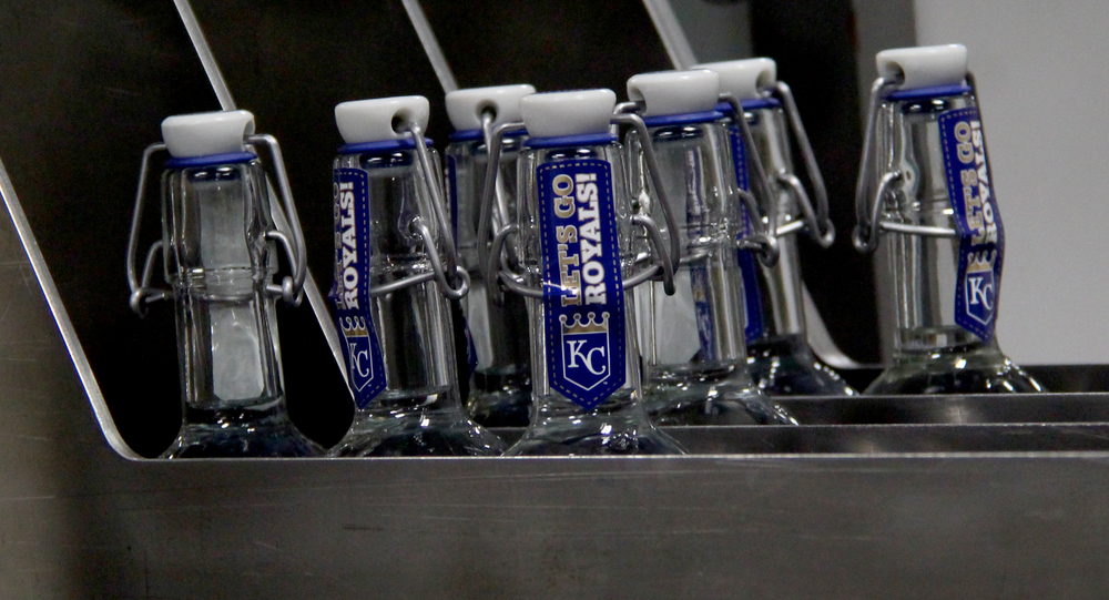 ROSS MARTIN/Citizen photo Limited edition 2015 Royals World Series champions bottles come through the machinery after being sealed Thursday, March 17 at McCormick Distilling Company in Weston, Mo.
