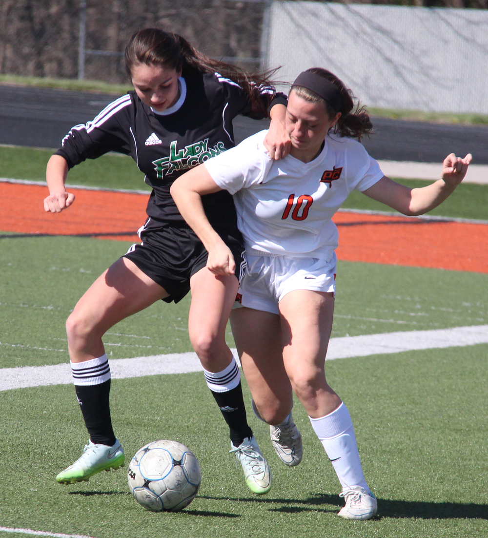 ROSS MARTIN/Citizen photo Platte County's Calle Boe attempts to hold off a Staley player in the Pirates 3-2 loss during a Platte County Invitational match on Monday, March 21.