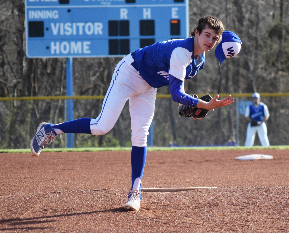 BRYCE MERENESS/Citizen photo West Platte senior pitcher Luke Horseman tries to catch his hat after it was blown off his head delivering a pitch against Maur Hill-Mount Academy on Monday, March 21 at Benner Park in Weston, Mo.