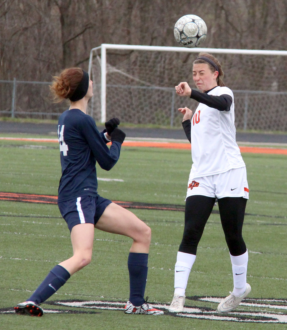 ROSS MARTIN/Citizen photos Platte County junior defender Calle Boe, right, heads a clearance during the Platte County Invitational championship match against Liberty North on Thursday, March 24 at Pirate Stadium.