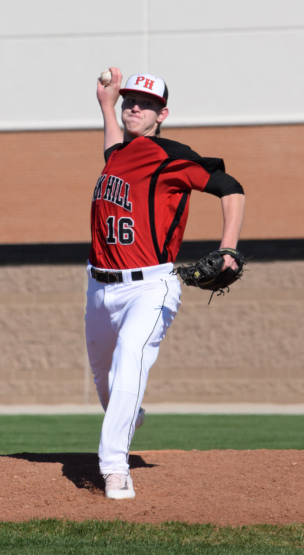 BRYCE MERENESS/Citizen photo Park Hill senior Chris Bolte delivers a pitch in the opening game of a doubleheader on Saturday, April 2 at Park Hill High School in Kansas City, Mo.