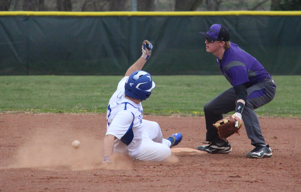 ROSS MARTIN/Citizen photo West Platte junior Kyle Tabaka slides safely into second base in front of a throw intended for North Platte senior shortstop Andrew Roberts during a KCI Conference game against North Platte on Wednesday, March 30 at Dean Park in Dearborn, Mo.