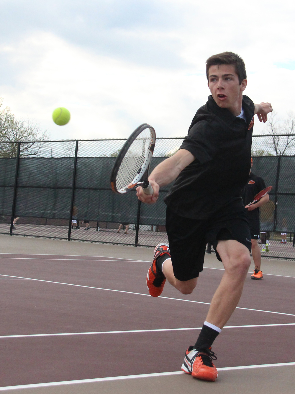 ROSS MARTIN/Citizen photo Platte County senior Zack Regan hits a backhand near the net during the No. 1 doubles match against Winnetonka during a dual Thursday, March 31 at Winnetonka High School in Kansas City, Mo.