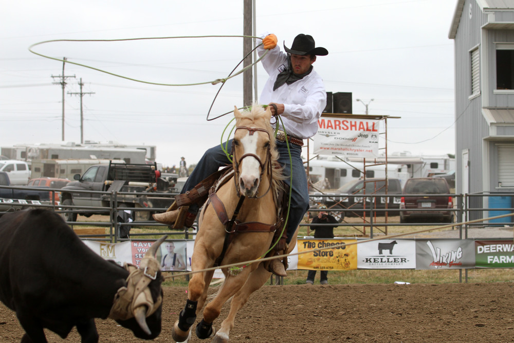 Wild Ones Photography North Platte senior Blake Toliver goes to lasso a steer during a team roping competition in a rodeo held this past October in Marshall, Mo. Toliver moved to Platte County three years ago and plays baseball for the high school but recently signed a scholarship to continue his rodeo career at Kansas State.