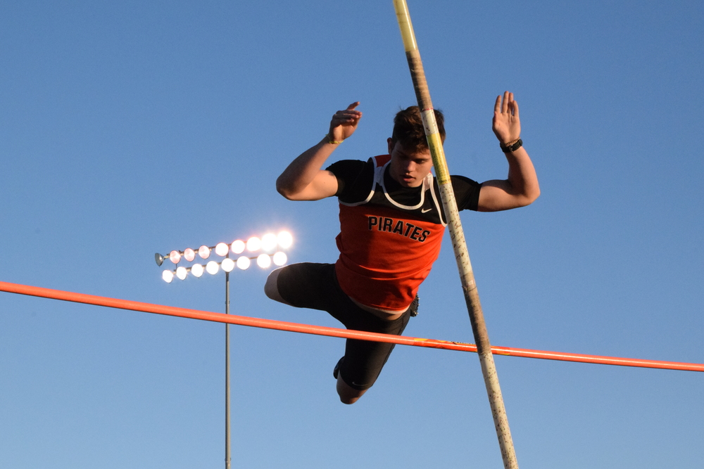 BRYCE MERENESS/Citizen photo Platte County's Jake Tomlinson clears the bar during the pole vault competition of the Kearney Classic on Friday, April 8 at Kearney High School in Kearney, Mo.