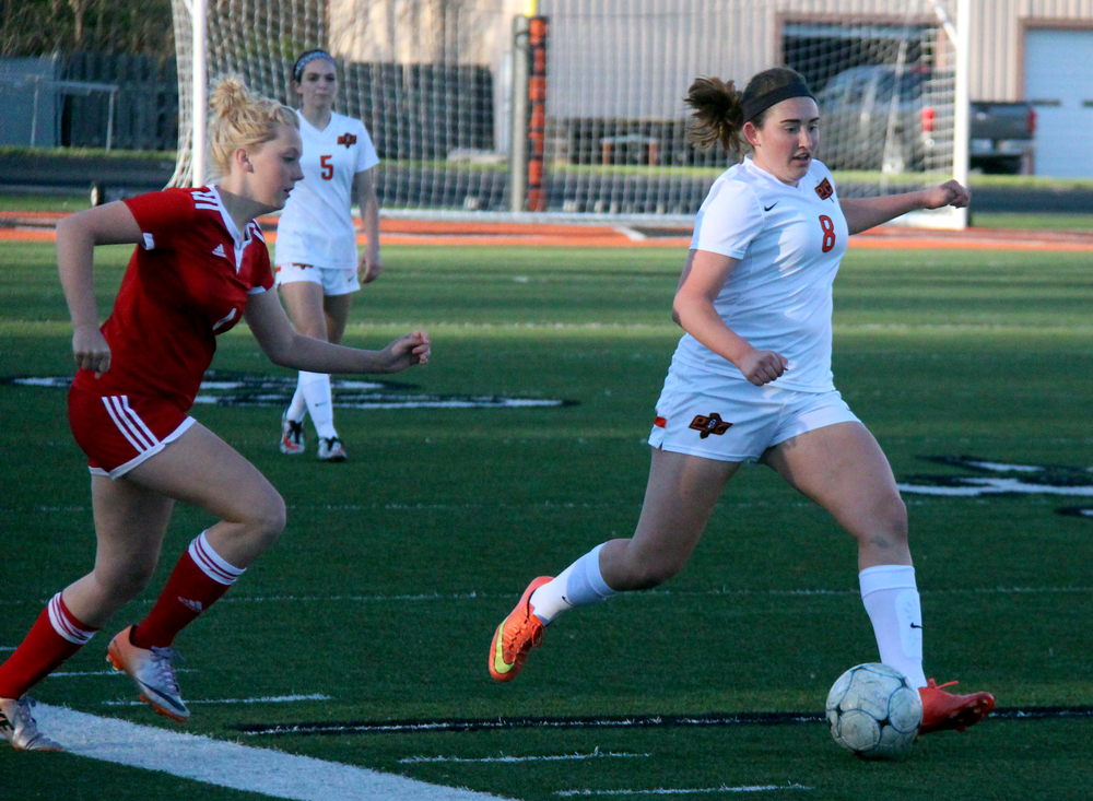 ROSS MARTIN/Citizen photo Platte County senior defender Haley Valentine, right, dribbles away from a Cardinals defender. Valentine is the lone starter on the backllne who played that position last season.