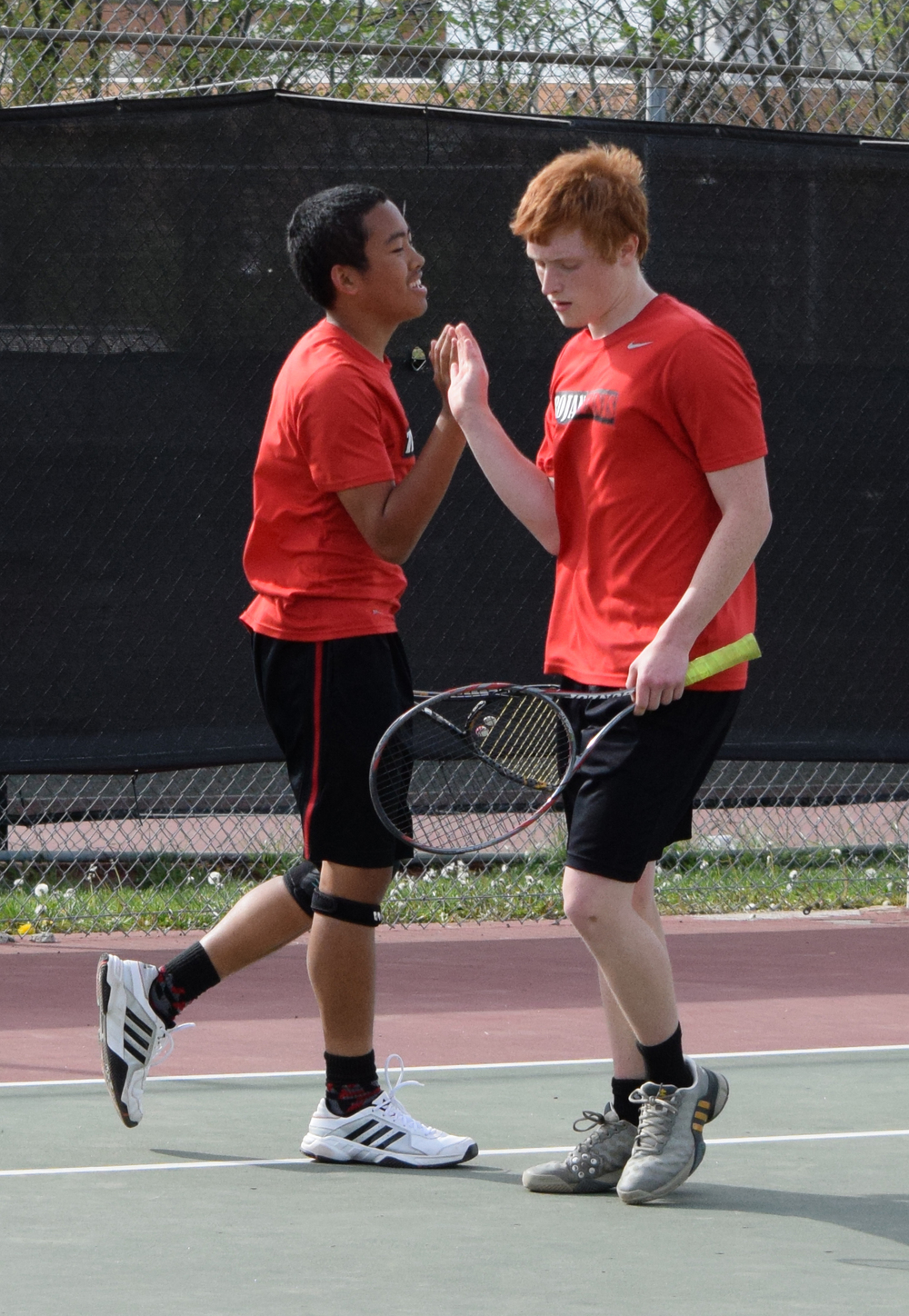BRYCE MERENESS/Citizen photo Park Hill's No. 2 doubles team of Chandler To, left, and Joel Lesher react after winning a point in a dual against Pembroke Hill on Friday, April 15 at Plaza Tennis Complex in Kansas City, Mo.