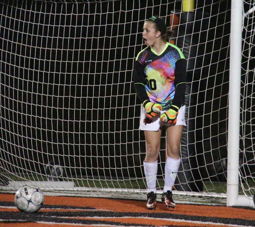 ROSS MARTIN/Citizen photo Platte County goalkeeper Kaylyn Hathaway celebrates after saving a penalty kick in a shootout with Smithville on on Friday, April 15 at Pirate Stadium.