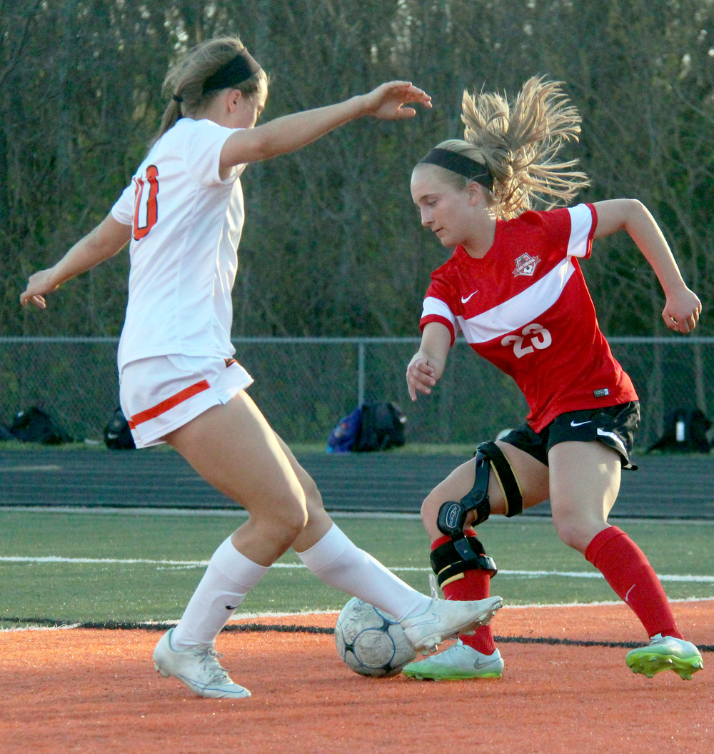 ROSS MARTIN/Citizen photo Park Hill striker Alison Walls, right, makes a move around a Platte County defender in a game Wednesday, April 13 at Pirate Stadium.