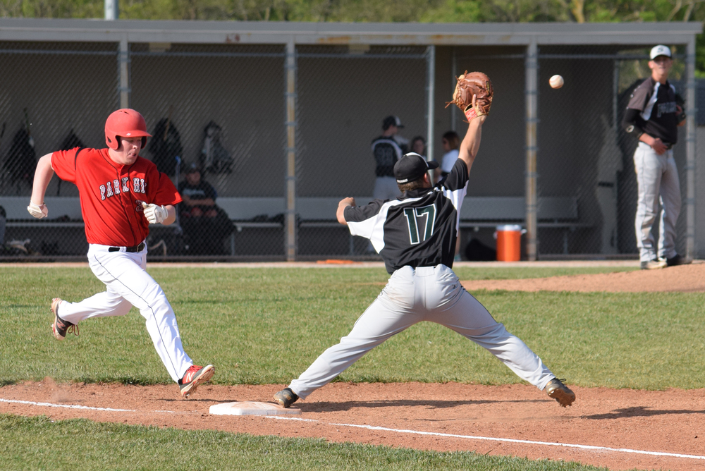 BRYCE MERENESS/Citizen photo Park Hill junior right fielder Peyton Morehouse, left, stretches to beat out an infield single during the Trojans' Northland Invitational finale against Staley on Friday, April 22 at Staley High School in Kansas City, Mo.